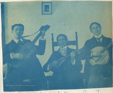 Possibly members of the University's Mandolin, Banjo and Guitar Club. All persons in the photograph are unidentified.