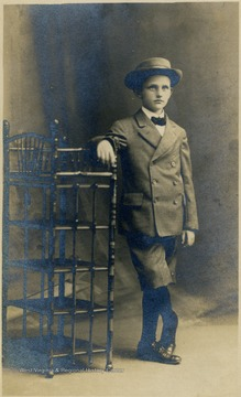 A young boy (most likely 9 or 10), wearing a suit and a hat.