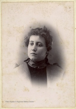Cabinet card portrait of a young woman. Several of the Burchinal family are from Preston County, W. Va.