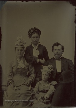 "All persons are unidentified. Information included with the photograph ""Mrs. Mattey Everly""."