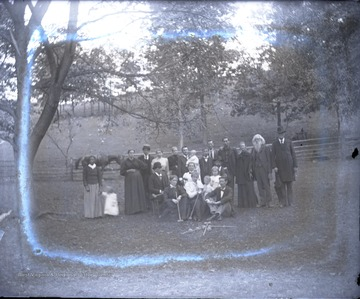 Outside family portrait, only person identified is J. J. Charleton, second from the right.