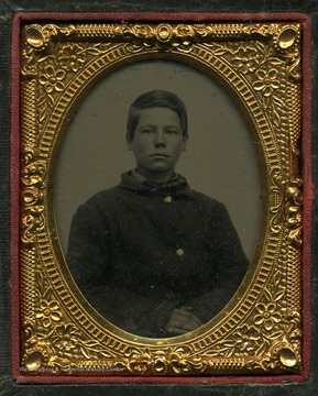 Probably a tintype photograph of an unidentified boy.