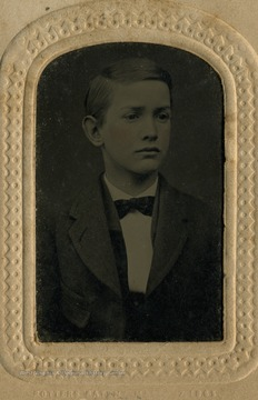 Portrait of young boy, possible the son of Nathaniel and Matilda Bailee. The album holding this tintype has the name card of Charles R. Bailee attached on the inside cover.