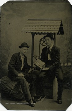 Frank Holme (right) from Preston County, West Virginia, was a nationally known artist and newspaper illustrator. In this staged photograph he pretends to share soup with an unidentified friend.