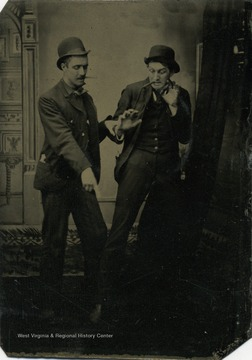 Frank Holme, right, from Terra Alta, West Virginia was a renown artist and newspaper illustrator. Here he poses with an unidentified friend in a staged photograph.