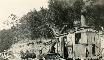 Erie steam shovel or excavator being used to remove dirt for the road bed.