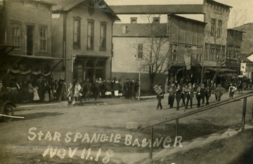"celebration marking the end of World War I. Postcard photograph is labeled, ""Star Spangle Banner""."