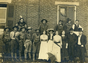 Cast of the play in costume, only identified members are: Oral Hathaway- third from left; Budge Marshall- center back