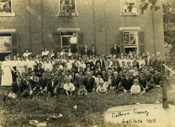Unidentified staff and students of all ages gathered outside of the school for a picture.