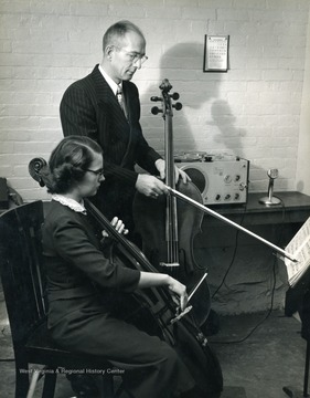 Student being taught to play the up-right bass in what was once West Virginia University's music department, now known as the creative arts department.