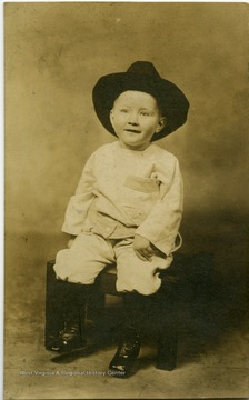 Postcard photograph of Cowboy toddler John Brando
