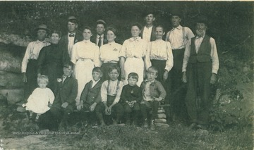 "Back Row, L to R: John Bodkin, Elmer Cunningham, Osburn Bodkin, Alby Cunningham, Endress Hartman, Michael Bodkin. 2nd Row, L to R: Louie Cunningham Bodkin, Dolley Mullennex, Elva Cunningham (Mullennex), Gertrude May Bodkin Judy, Sarah E. Hartmen. 3rd Row: Luthur Bodkin, Omer Bodkin, Oscar ""Bill"" Bodkin, Wade Hartmen, Odis Bodkin, Isom Bodkin."
