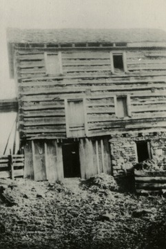 "Rear view of the Worley Fort. The ""Worleys"" were considered the first settlers in Blacksville area, circa 1783. The building was three stories high. At one time had a barricade or stockade fence around it. Just before reaching the third floor, there was a fake floor about one and half feet high to slip children into in a prone position during periods of danger from Indian attacks."