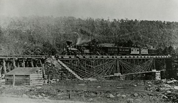 An early Baltimore and Ohio passenger train shown atop one of Wendel Bollman's famous bridges.