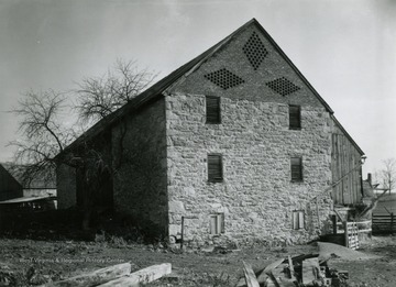 Viewed from the South West. This barn has asymmetrical gable ends indicating it was built before 1840.