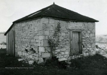 Outbuilding which is probably a meat house on a large farm, viewed from the south-west.