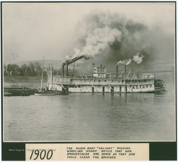 "The ""Valiant"" steaming by the Wheeling Wharf. Notice her smokestacks are reclined so she could clear the bridges"