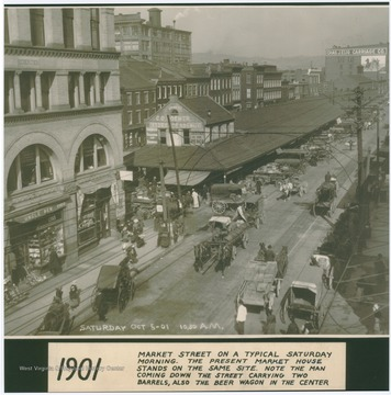 "The caption describes the scene as ""Market Street on a typical Saturday morning. The present Market House stands on the same site. Note the man coming down the street carrying two barrels also the beer wagon in the center."""