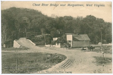 "Postcard photograph of a dirt paved road to the bridge over Cheat River. A house and a structure with a storefront fascade is situation at the near side of the bridge. Also inscribed on the image, ""Published by Dawson and Co. Morgantown, West Virginia""."