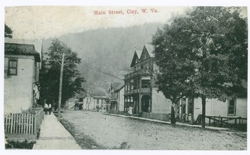 Postcard photograph of dirt paved street in town of Clay, county seat of Clay County.