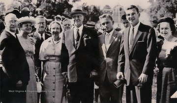 "Caption on original photo reads: ""The last group picture of the Benedum family, taken at the dedication of the Civic Center in Bridgeport in July 1957. Left to right: Paul and his wife Willeen, Claxton, Clora (Mashburn), Mr. Benedum, Michael Late Benedum, II, son of Darwin, Paul G. Benedum Jr., and Eugenia (Mrs. Darwin Benedum).Michael Benedum was considered the modern day founder of Bridgeport, W. Va. After 70 years of working in the oil and gas industry, Benedum created many projects to restore and beautify the city of Bridgeport."""