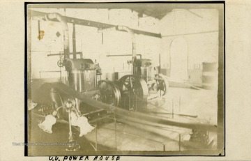 Interior view of machinery at the U.U. Power House. (From postcard collection legacy system.)