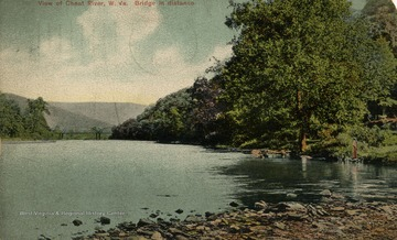 Woman stands by the river to the right. (From postcard collection legacy system.)
