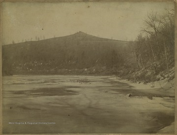Photo of Dorsey's Knob from the partially frozen river.