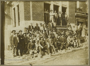 A group photo taken in front of the WVU building still under construction.