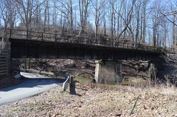 Railroad bridge where Jones Raiders on April 30, 1863 dumped locomotive and cars into Simpson Creek, a tributary of the West Fork River. The raid led by General William E. Jones was intended to interrupt traffic on the Baltimore and Ohio Railroad and deplete Union supplies.