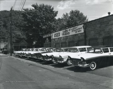 Photo of the car lot exhibiting Ford vehicles.