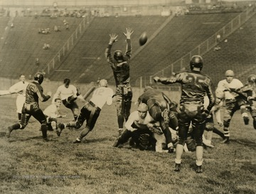 West Virginia University vs. University of Pittsburgh football game. Print number 198.