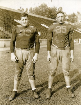 "Fred Buskier on left and ""Moose"" Hodges on right. West Virginia University football players. Print number 202b."