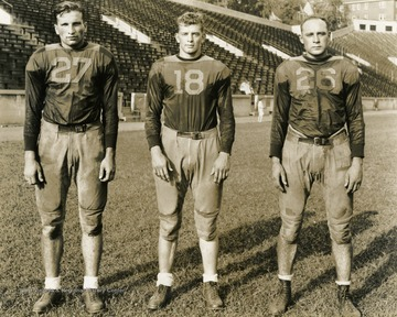 From left to right: Nebera, Carder, Ingraham. West Virginia University football players. Print number 202h.