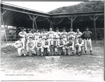 "1st row, L to R: Dough Richmond, Dickie Wiseman, Johnny ""Stooge"" Stewart, ""Rowhandle"" Keaton, David Hess, Emerson Carden, Jimmy Kerr, and Jimmy Harvery. 2nd row, L to R: Dwight Shirey, Randy Scott, Bobby Ratliff, Bobby Webb, Paul Phipps, Glen McCormick, Bill Humphreys, ""Hammy"" Brown, ""Chubby"" Willey, and Coach ""Buck"" Porterfield."