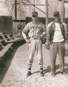 Player and coach of the Hinton baseball team pictured in the adjacent Mercer county, probably for a game.