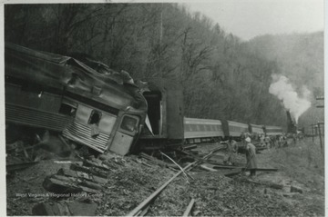 A group examines the damage of the wreck along the C&O railroad.
