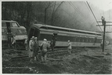 Unidentified workers examine the damage along the C&O railroad.