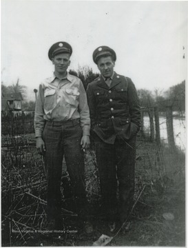 Raymond is on the left. Dewey is on the right. The two are pictured in their uniforms.