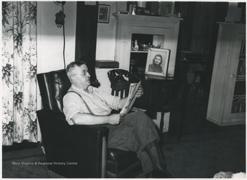Keller pictured reading in his chair inside his home at 112 Greenbrier Drive near Hinton, W. Va.