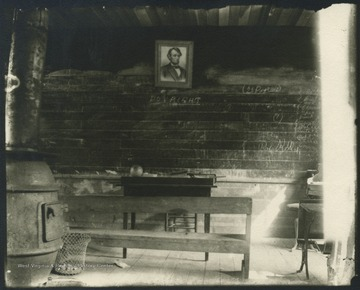 A look inside the presumed school house. A portrait of Abraham Lincoln hangs on the wall.