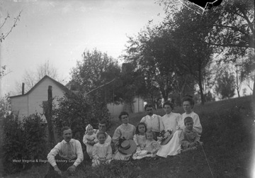 "Photographer, James Green sitting on the right, (""after the Panic of 1907""); Front row: to James Sr.'s right is Virginia, to the far left is James Green Jr., Back row: the 2nd woman left might be Edith Green (photographer's wife)."