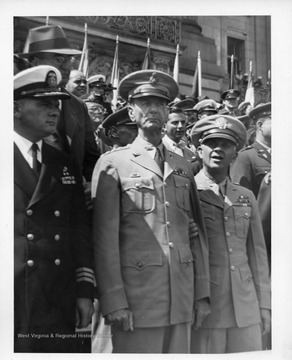 Center: US Army General Jonathan M. Wainwright, Commander of Allied Forces in the Philippines at the time of their surrender to Japan in 1942.  Wainwright was a POW, held by the Japanese until his liberation in August 1945.