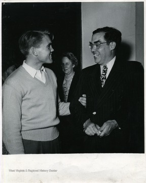 The young man with Senator Holt is not identified.