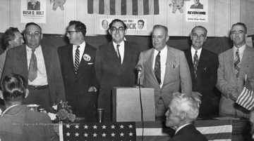 Rush Holt stands with other candidates during a campaign rally.