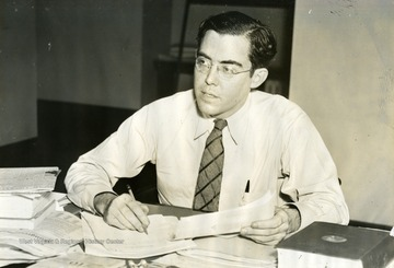 United States Senator Rush D. Holt from Weston, West Virginia, pauses while working at his desk.