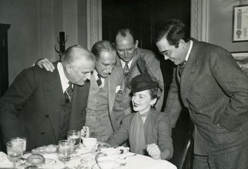 "Back of photograph reads: ""Olivia de Havilland, film star here for the Washington premiere of ""Gone With The Wind"", pays a visit to the capitol. Where she was met by four bachelor Senators. Left to right are: Sen. Joe Guffey, Sen. Theodore Green, Sen. Richard Russell, and Rush D. Holt."