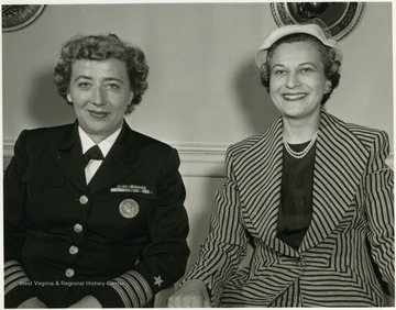 Inscribed on the back of the photo: ' Mrs. Rush D. Holt, DACOWITS member from Charleston, West Virginia and Captain Winifred R. Quick, Assistant Chief of Naval Personnel (Women) (Waves) are pictured in the Department of Defense while attending the April 6-7, 1959 meeting of the Defense Advisory Committee on Women in the Service.'