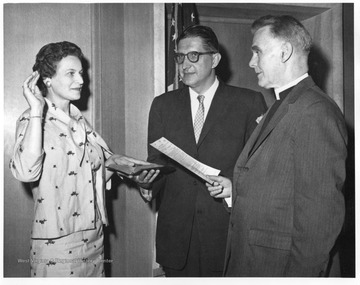 Helen Holt swearing in to new job at FHA.  Dr. Frederick Brown Harris is pictured as well, along with a Methodist Church Chaplin.