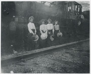 Mrs. R.O. Murrell pictured second from left. Others are unidentified.